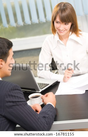 Two businesspeople working together at office - stock photo