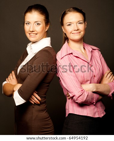 Two businesswoman over brown background - stock photo