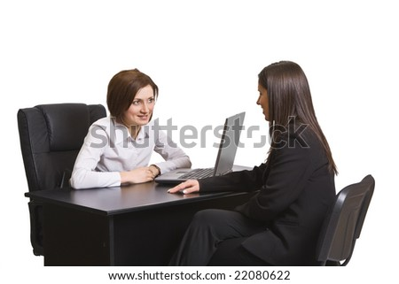 Two businesswomen at an interview in an office.
