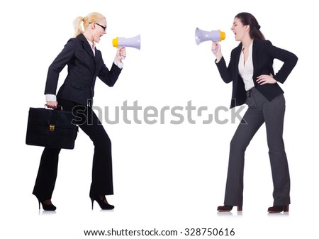Two businesswomen holding loudpspeakers isolated on white
