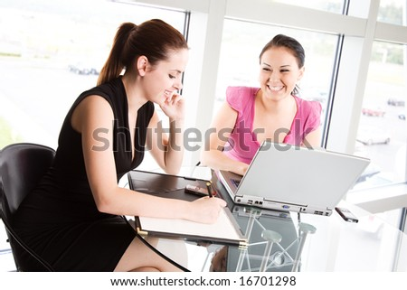 Two businesswomen in a meeting at the office - stock photo