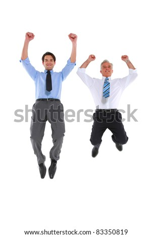 two businesswomen jumping and rejoicing - stock photo