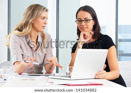 Two Businesswomen Meeting In Office - stock photo