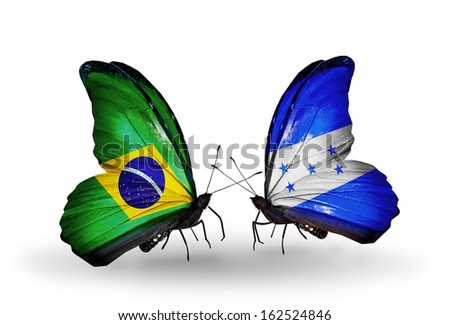 Two butterflies with flags on wings as symbol of relations Brazil and Honduras - stock photo
