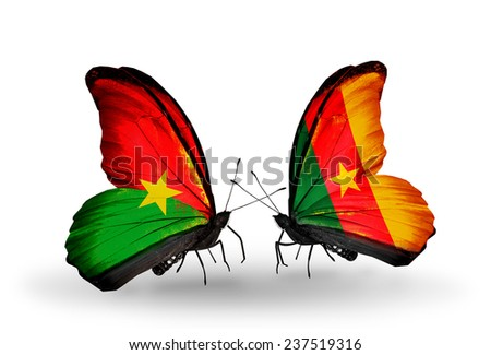 Two butterflies with flags on wings as symbol of relations Burkina Faso and Cameroon - stock photo