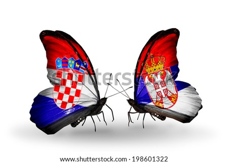 Two butterflies with flags on wings as symbol of relations Croatia and Serbia - stock photo