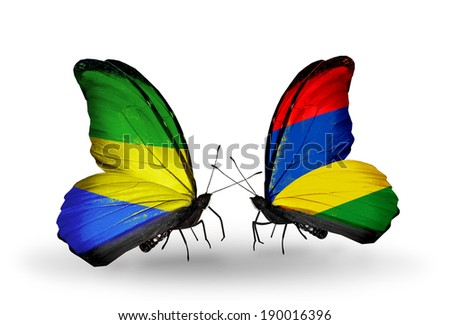 Two butterflies with flags on wings as symbol of relations Gabon and Mauritius