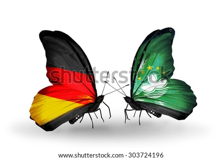 Two butterflies with flags on wings as symbol of relations German and Macau - stock photo