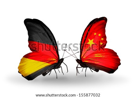Two butterflies with flags on wings as symbol of relations Germany and China - stock photo