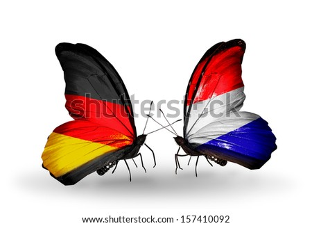 Two butterflies with flags on wings as symbol of relations Germany and Holland - stock photo