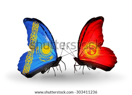 Two butterflies with flags on wings as symbol of relations Kazakhstan and Kyrgyzstan - stock photo
