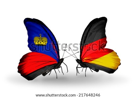 Two butterflies with flags on wings as symbol of relations Liechtenstein and Germany - stock photo