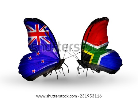 Two butterflies with flags on wings as symbol of relations New Zealand and South Africa - stock photo