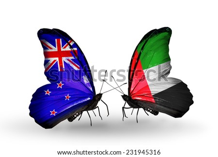 Two butterflies with flags on wings as symbol of relations New Zealand and UAE - stock photo