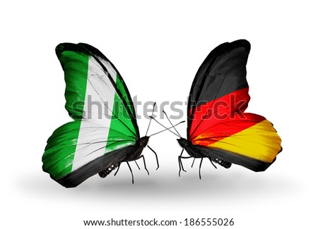 Two butterflies with flags on wings as symbol of relations Nigeria and Germany - stock photo