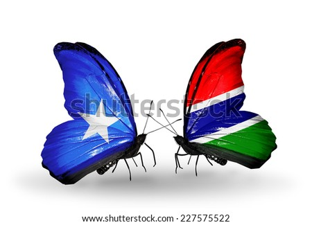 Two butterflies with flags on wings as symbol of relations Somalia and Gambia - stock photo