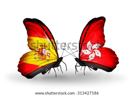 Two butterflies with flags on wings as symbol of relations Spain and Hong Kong - stock photo