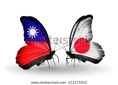 Two butterflies with flags on wings as symbol of relations Taiwan and Japan - stock photo