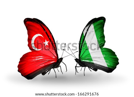Two butterflies with flags on wings as symbol of relations Turkey and  Nigeria - stock photo