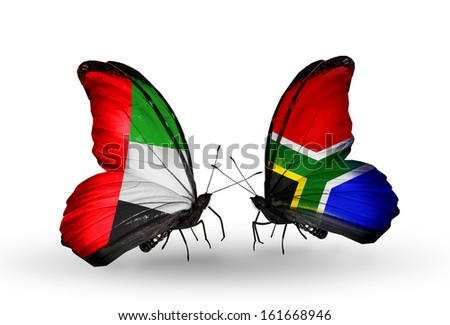 Two butterflies with flags on wings as symbol of relations UAE and South Africa - stock photo