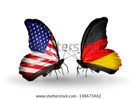 Two butterflies with flags on wings as symbol of relations USA and Germany - stock photo