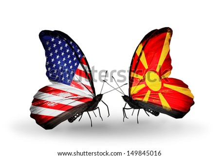 Two butterflies with flags on wings as symbol of relations USA and Macedonia - stock photo
