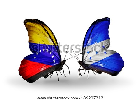 Two butterflies with flags on wings as symbol of relations Venezuela and  Honduras - stock photo