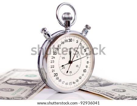 Two buttons stopwatch with banknotes on white background - stock photo