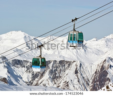 Two cabin of chairlift in Les Deux Alps -  France - stock photo