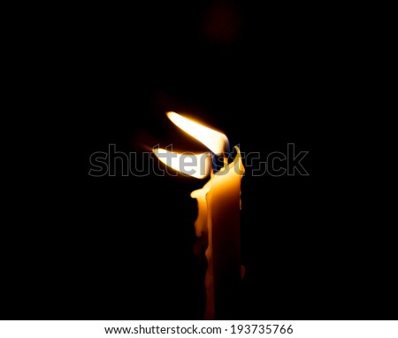two candle flame at night closeup - isolated - stock photo