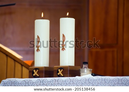 two candles lighted on the altar of the church during the celebration of the Mass / two burning candles - stock photo