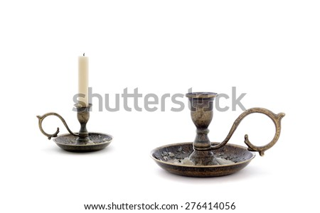 Two candlesticks isolated on white.Studio shot. - stock photo