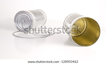 Two cans wired together somehow transfers audio to the other side childlike toy communication tool - stock photo