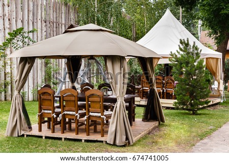 Two canvas tents with wooden tables and chairs. Vintage design of the restaurant in the & Two Canvas Tents Wooden Tables Chairs Stock Photo 674741005 ...
