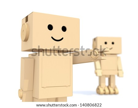 Two cardboard robots. one`s finger point to forward. - stock photo