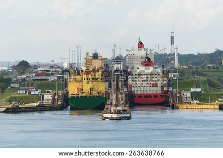 Two cargo ships enter the Gatun Locks from the Gatun Lake - stock photo