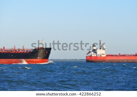 Two cargo ships sailing in blue sea close to Vlissingen, the Netherlands - stock photo