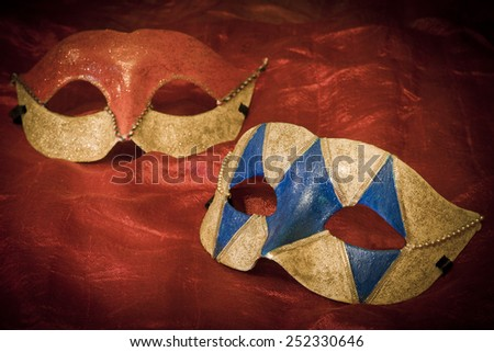 Two carnival masks on red background - stock photo