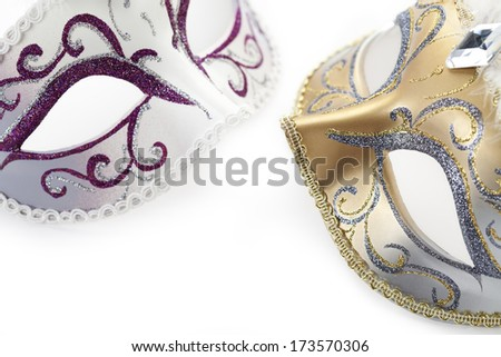Two carnival masks on white background - stock photo