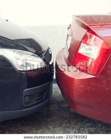 Two cars parked very close to each other  - stock photo