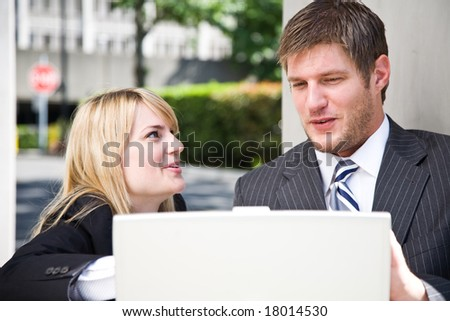 Two caucasian business people having a discussion - stock photo