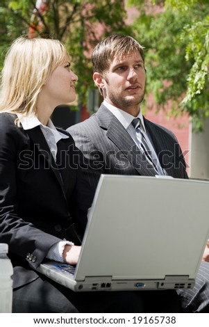 Two caucasian business people having a discussion outdoor