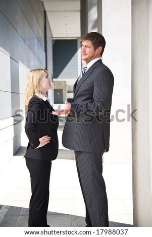 Two caucasian business people having an argument - stock photo