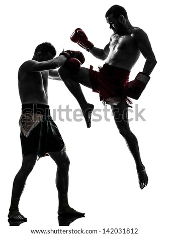 two caucasian  men exercising thai boxing in silhouette studio  on white background - stock photo