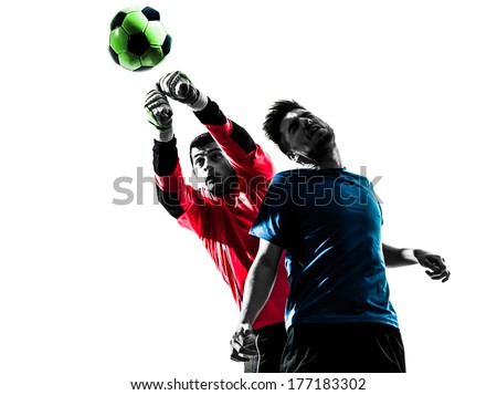 two caucasian soccer player goalkeeper men punching heading ball competition in silhouette isolated white background - stock photo
