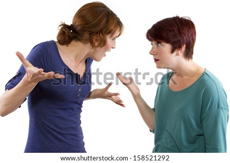 two Caucasian women arguing and distrusting each other - stock photo