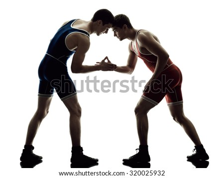 two caucasian wrestlers wrestling men on isolated silhouette white background - stock photo