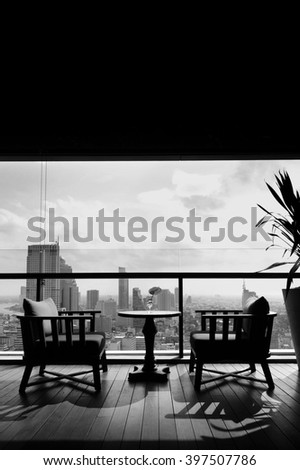 two chair at terrace restaurant with city view background - stock photo
