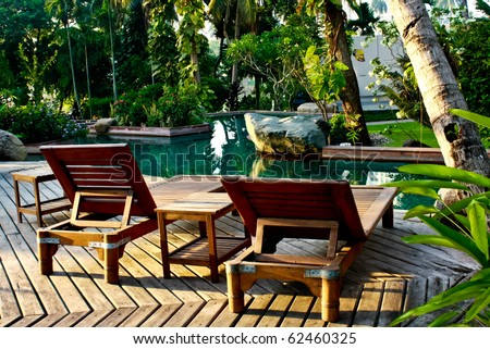 two chair near pool - stock photo