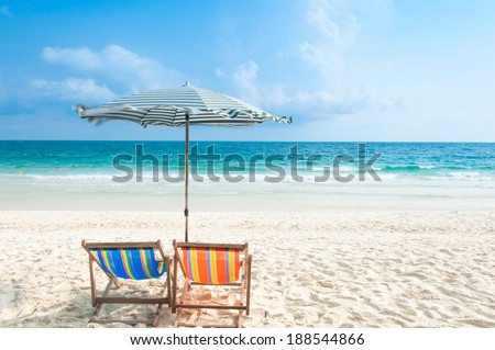 Two Chairs and Umbrella at the beach - stock photo